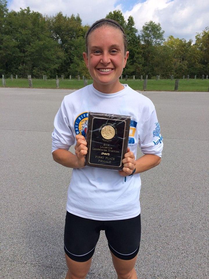 Wins Female Division of Louisville Landsharks Olympic Triathlon