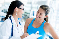 Female doctor at the gym with a patient